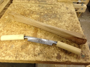 Shaving the crossmember with a draw knife reduces weight and gives the piece a pleasing shape.